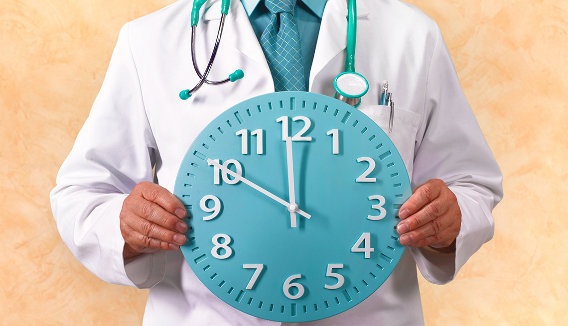 Doctor holding a clock