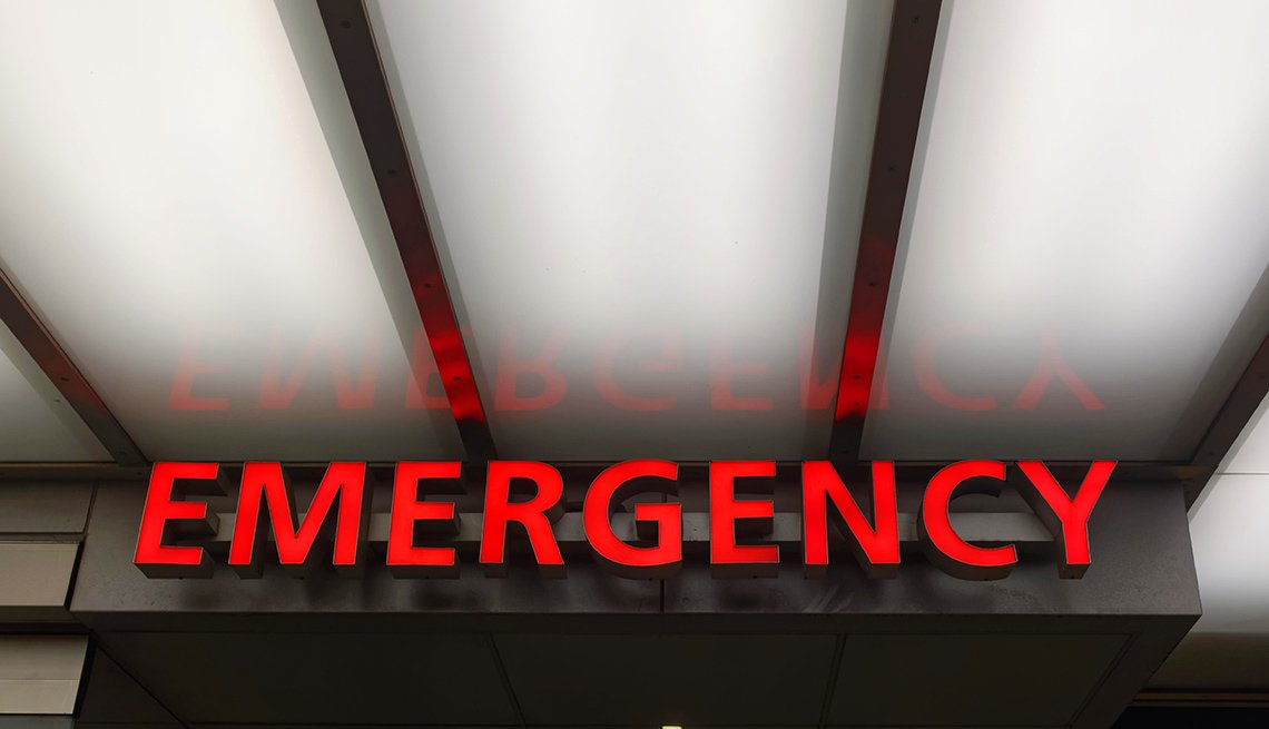A bright red emergency room sign