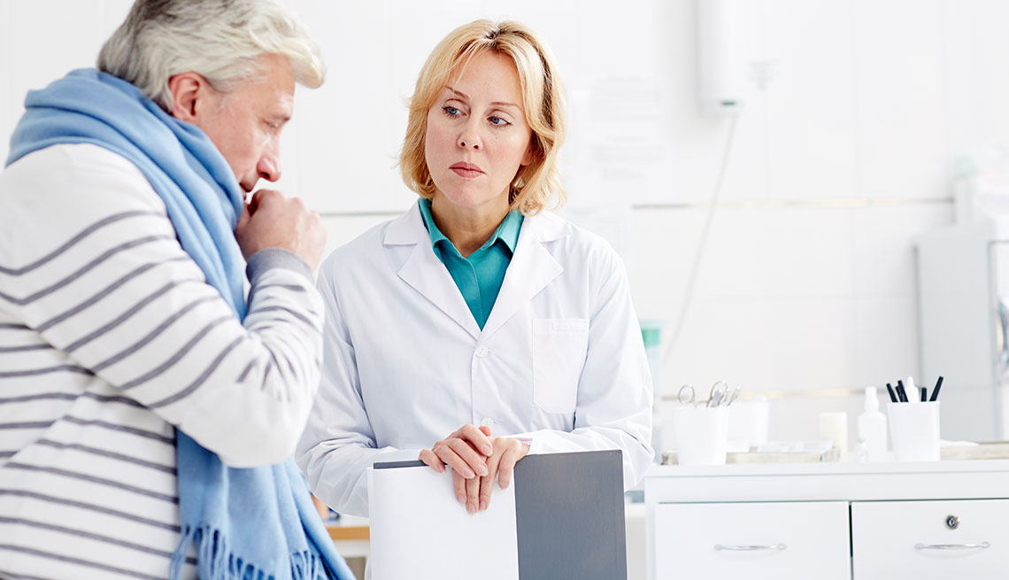 Doctor talking to patient at a hospital