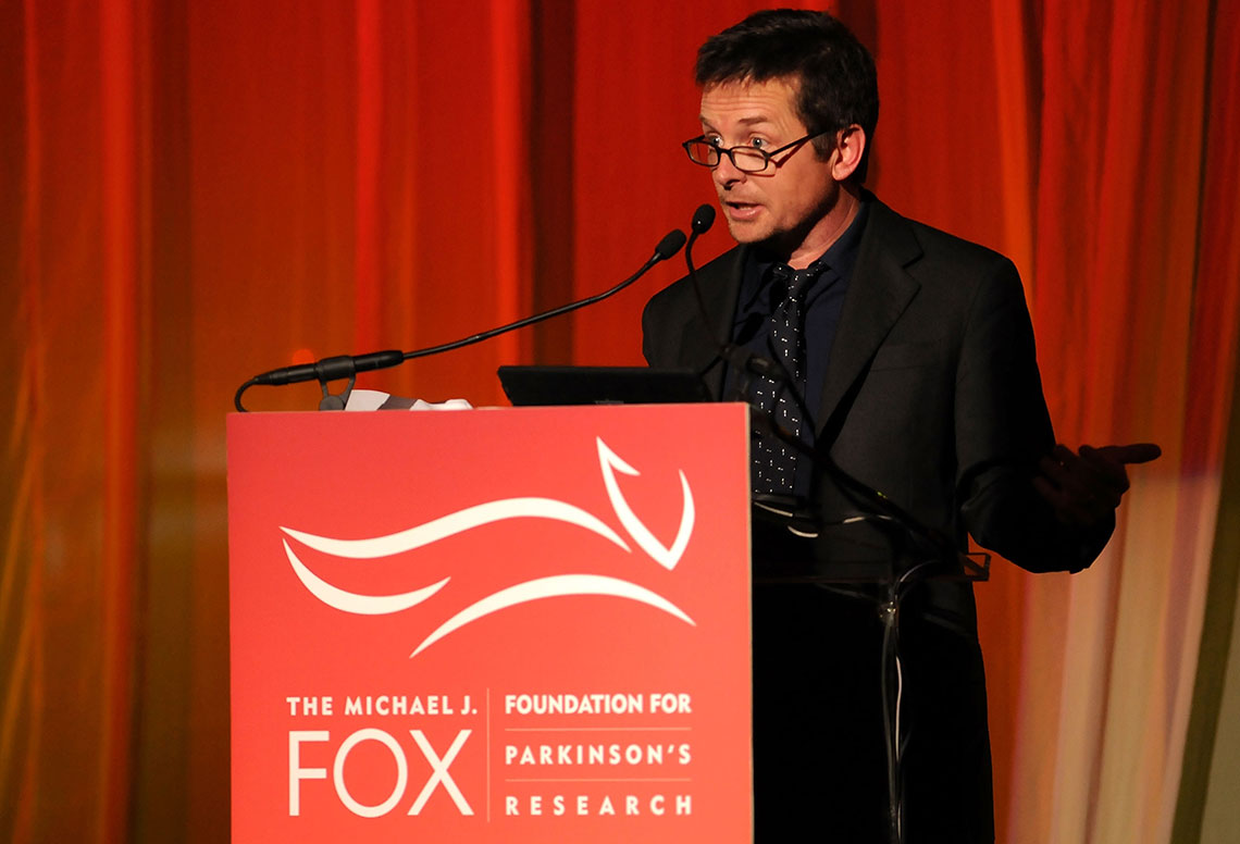 Michael J Fox speaking at a confrence for parkinson research
