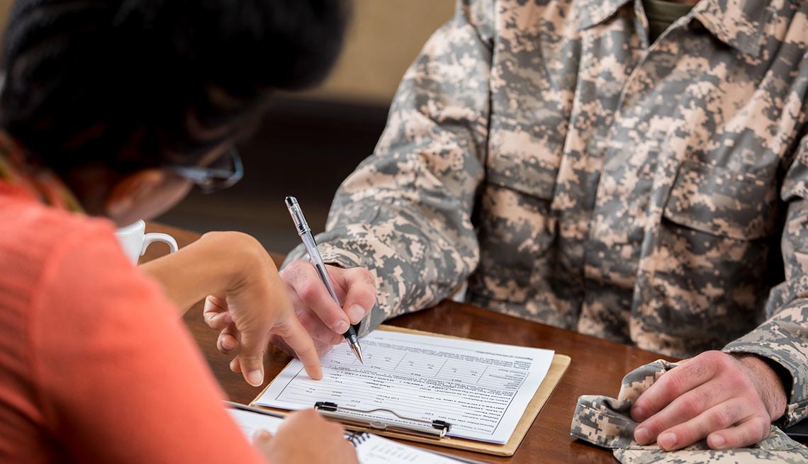 A veteran fills out a medical form
