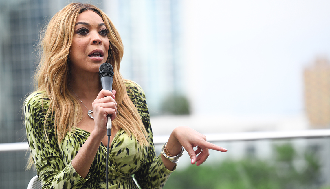 Wendy Williams with microphone at outdoor event