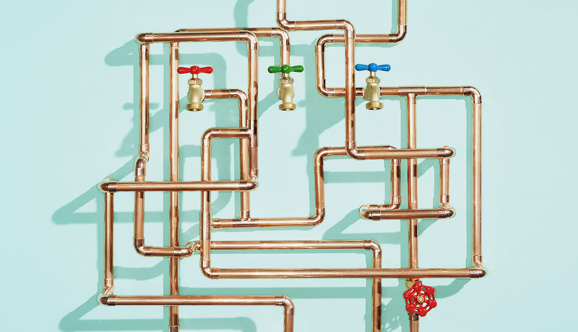 Tangle of water pipes and taps