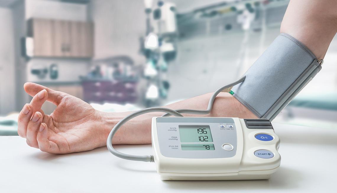 A man checks his blood pressure