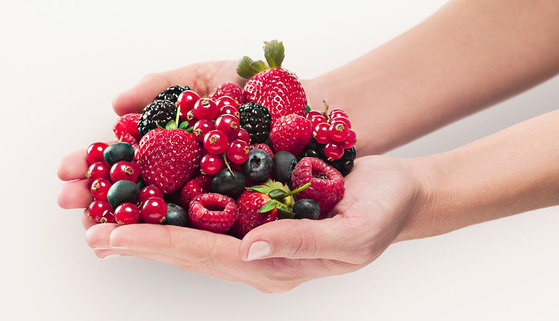 Hands holding berries