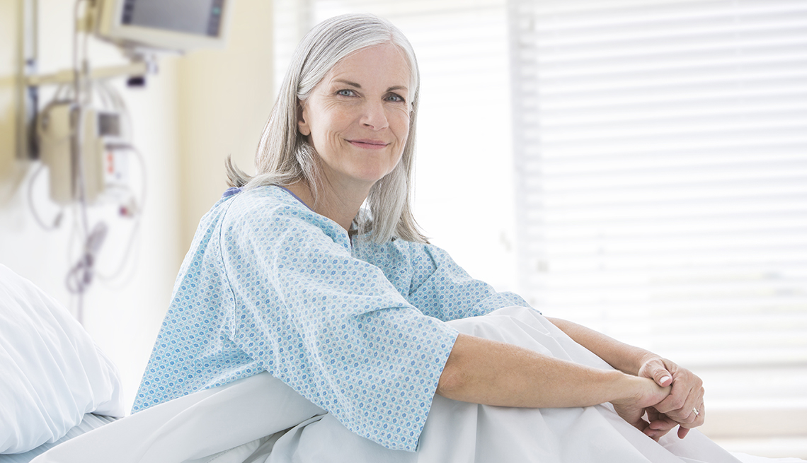 Portrait of smiling Caucasian woman in hospital bed