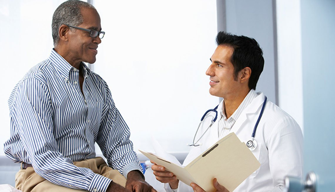 a doctor speaking with a patient at his office
