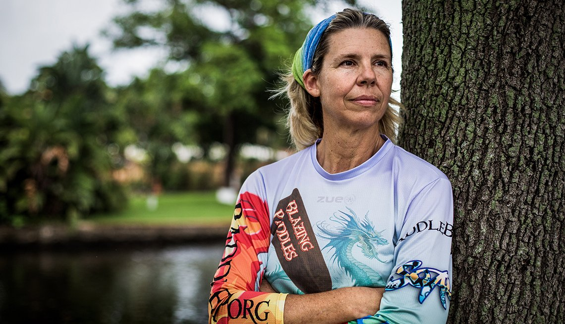 Judy Perkins stands for a portrait before competing in a canoe race in Wilton Manors, FL