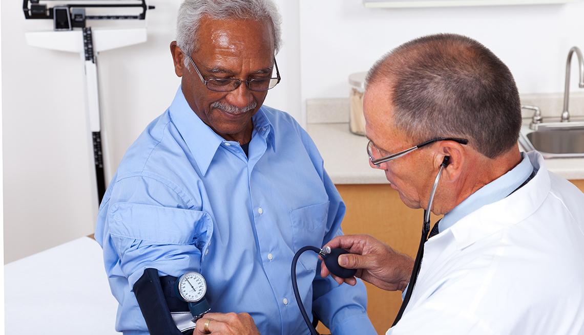Patient getting his blood pressure taken in a doctor's office.