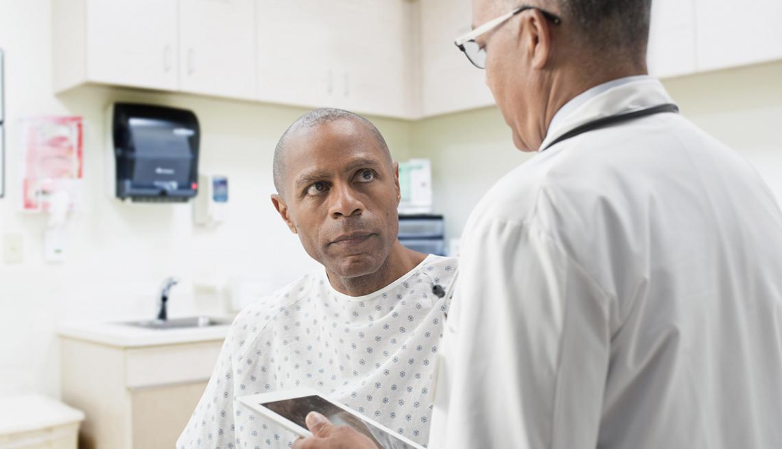 Doctor comforting patient in office
