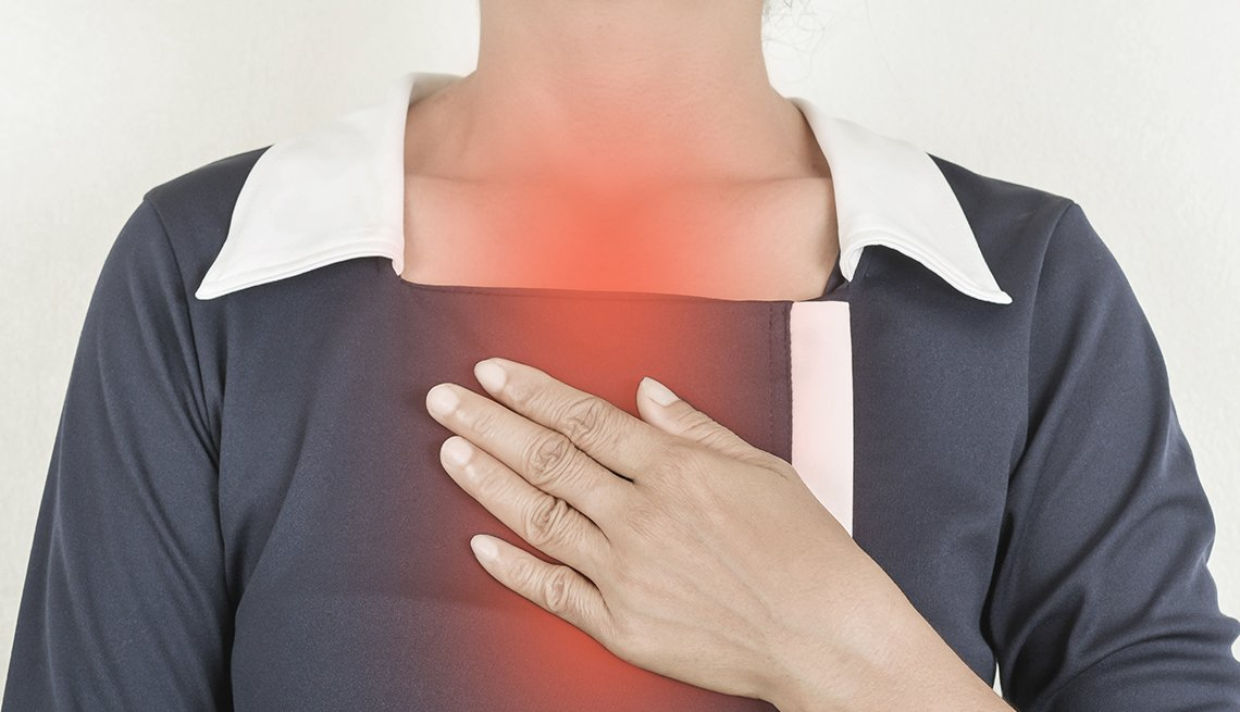 A woman with painful heartburn