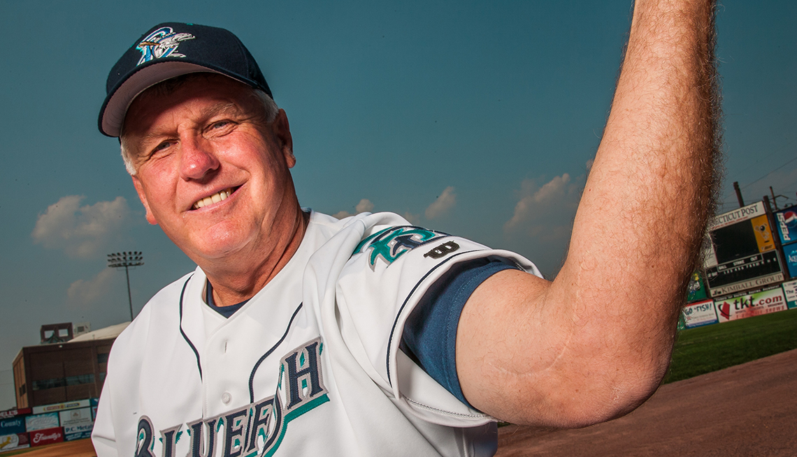 Pitcher Tommy John shows his surgery scar