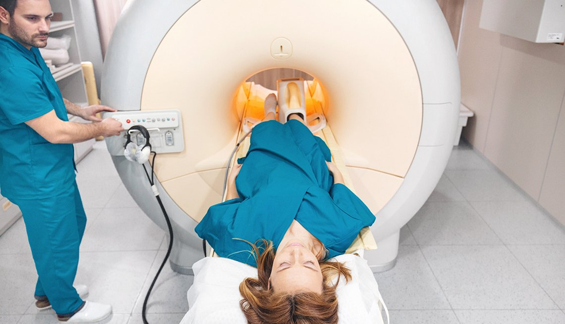 Woman being prepped to go through an MRI machine