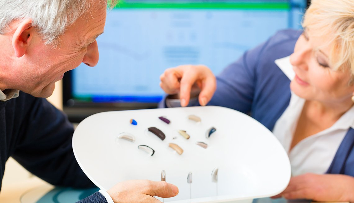 Woman choosing a hearing aid