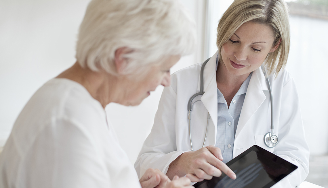 Doctor explains bone scan to woman