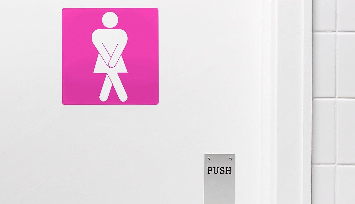 Pink bathroom door sign of a desperate woman needing to urinate.