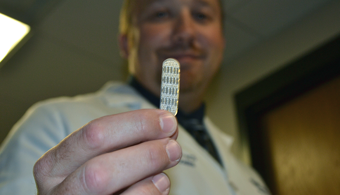 Doctor holding an electrode for a spinal-cord stimulator