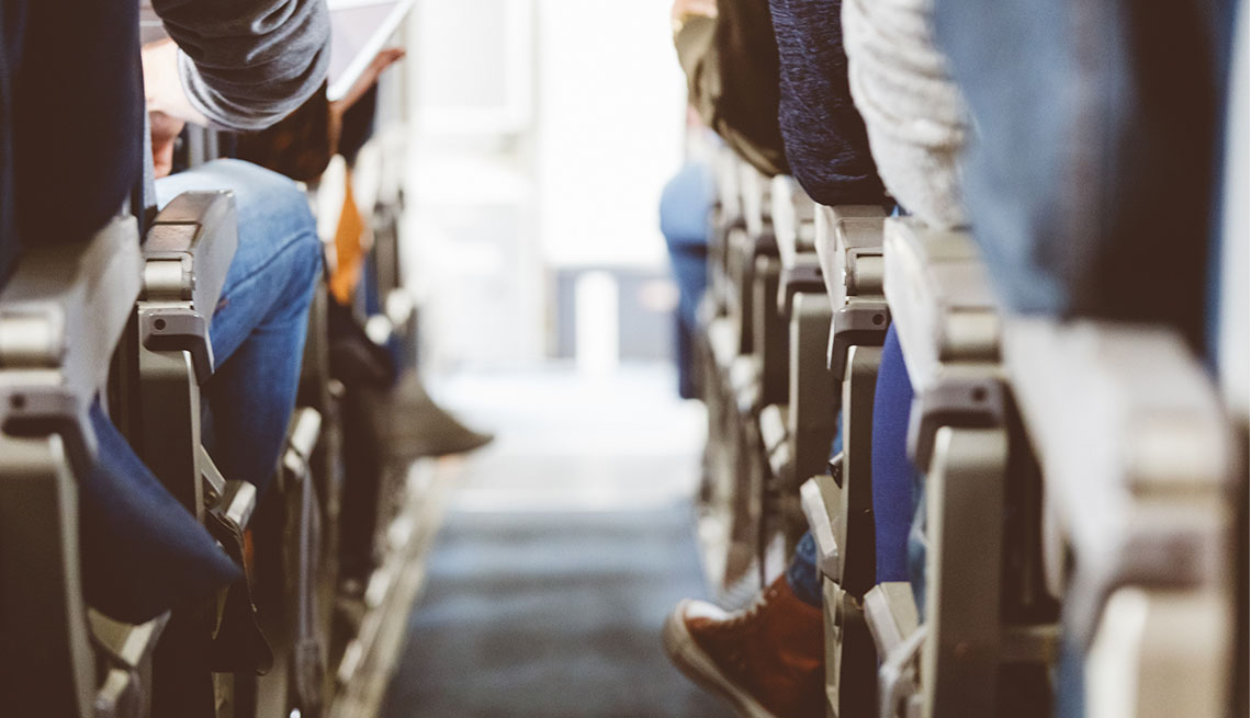 Airplane seats with passengers sitting