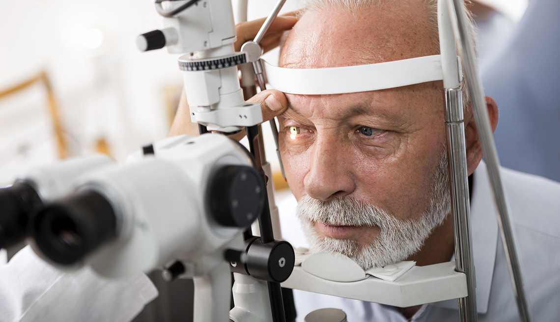 Ophthalmologist checking patient's eyes