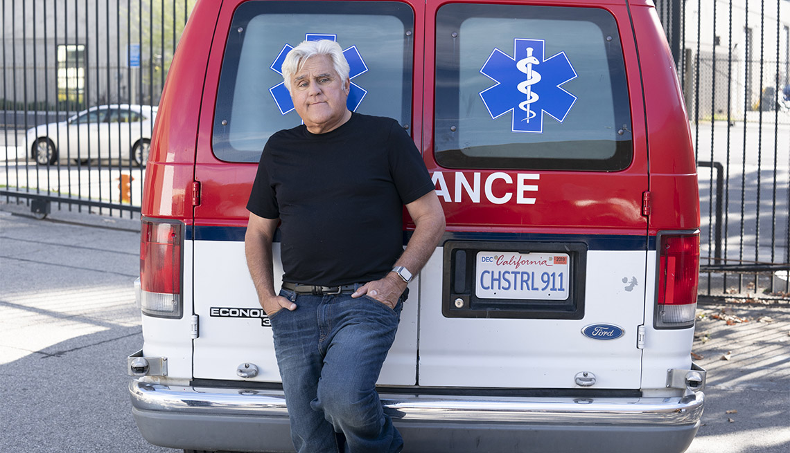 Comedian Jay Leno in front of an ambulance