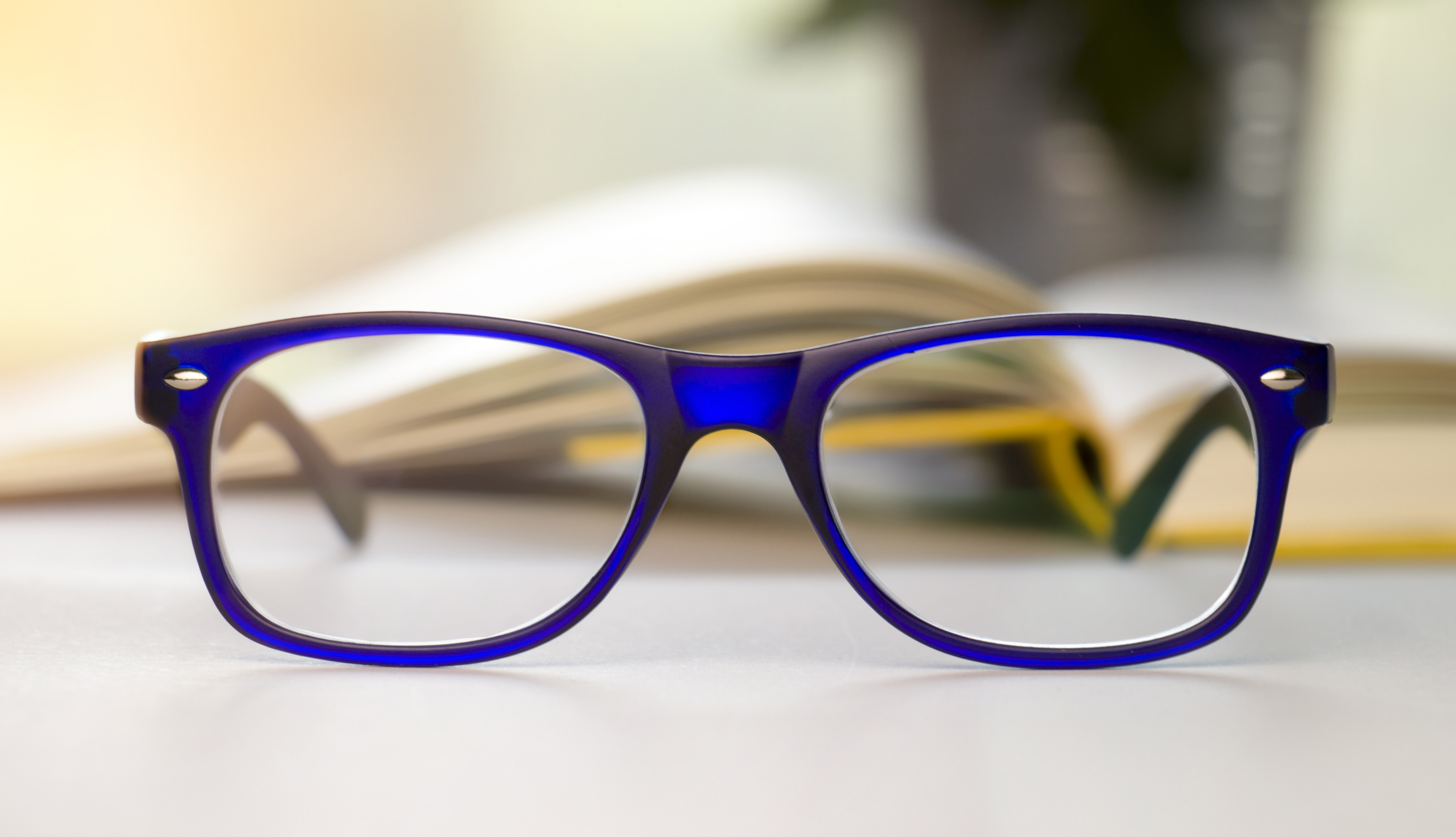 f2e94632d1c1 Stylish blue glasses on a blur background. Getty Images. As reading ...