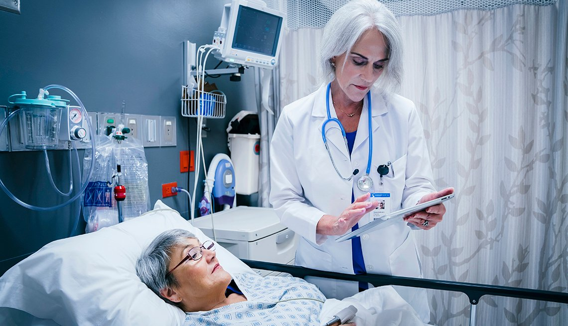 Doctor uses table to examine patient