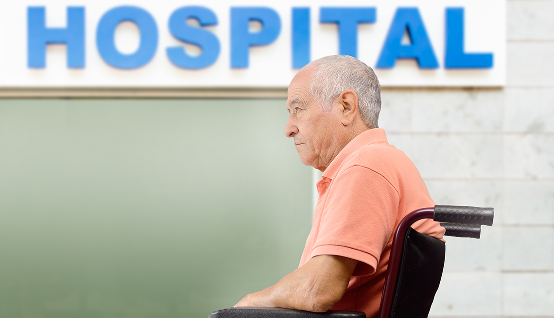 Man sitting in a wheelchair at a hospital