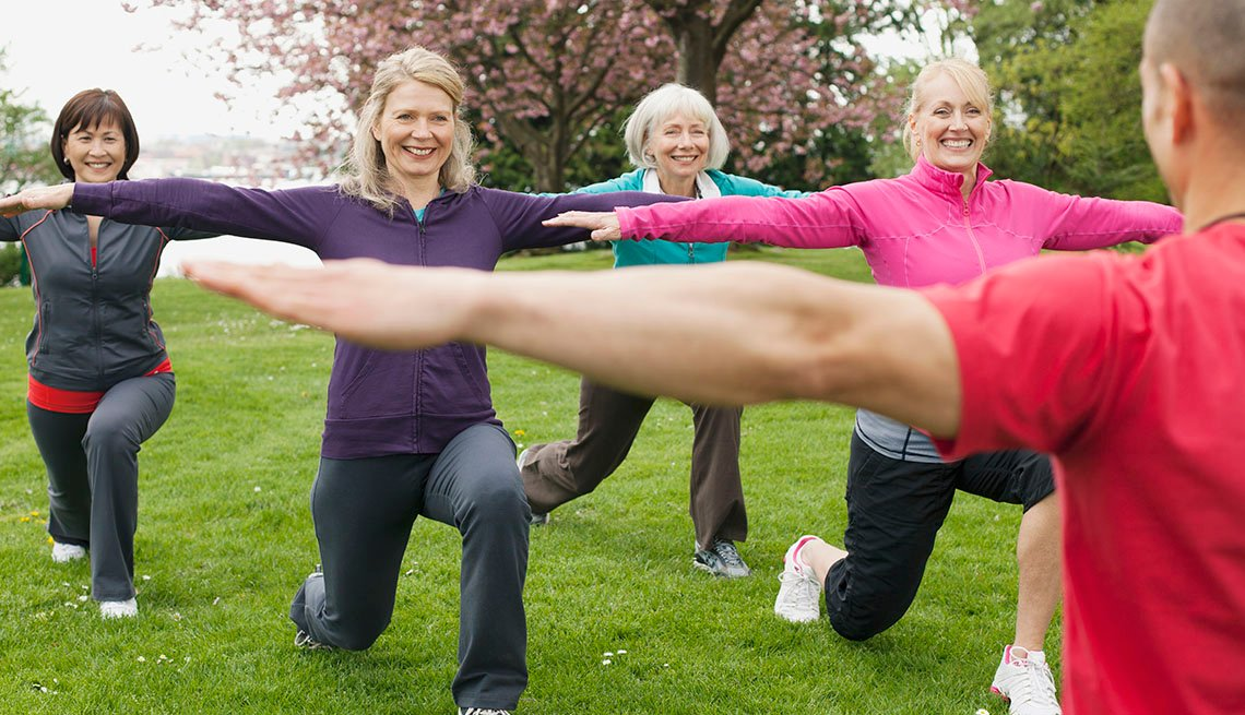 women in exercise class outdoors