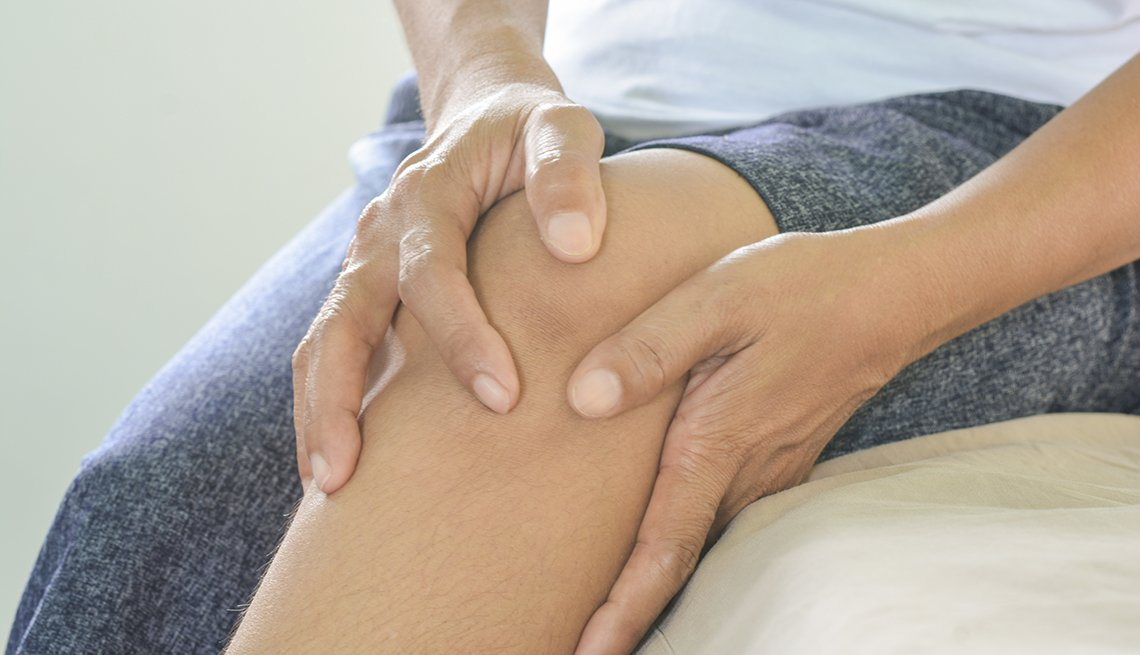 A woman holding her knee because of knee pain