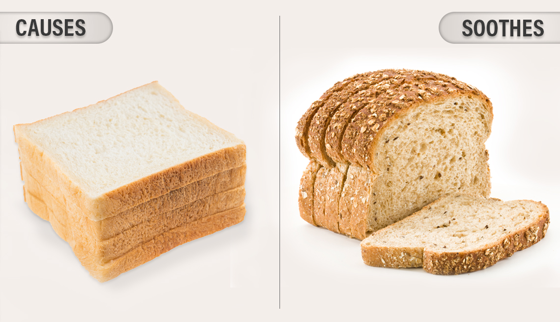 item 1 of Gallery image - stack of white bread with the caption causes inflammation is shown next to a stack of whole wheat bread labeled soothes inflammation
