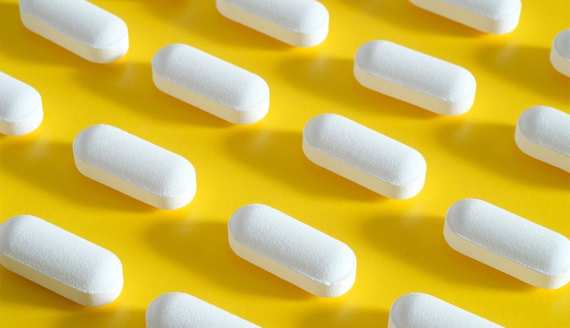 white pills on yellow background