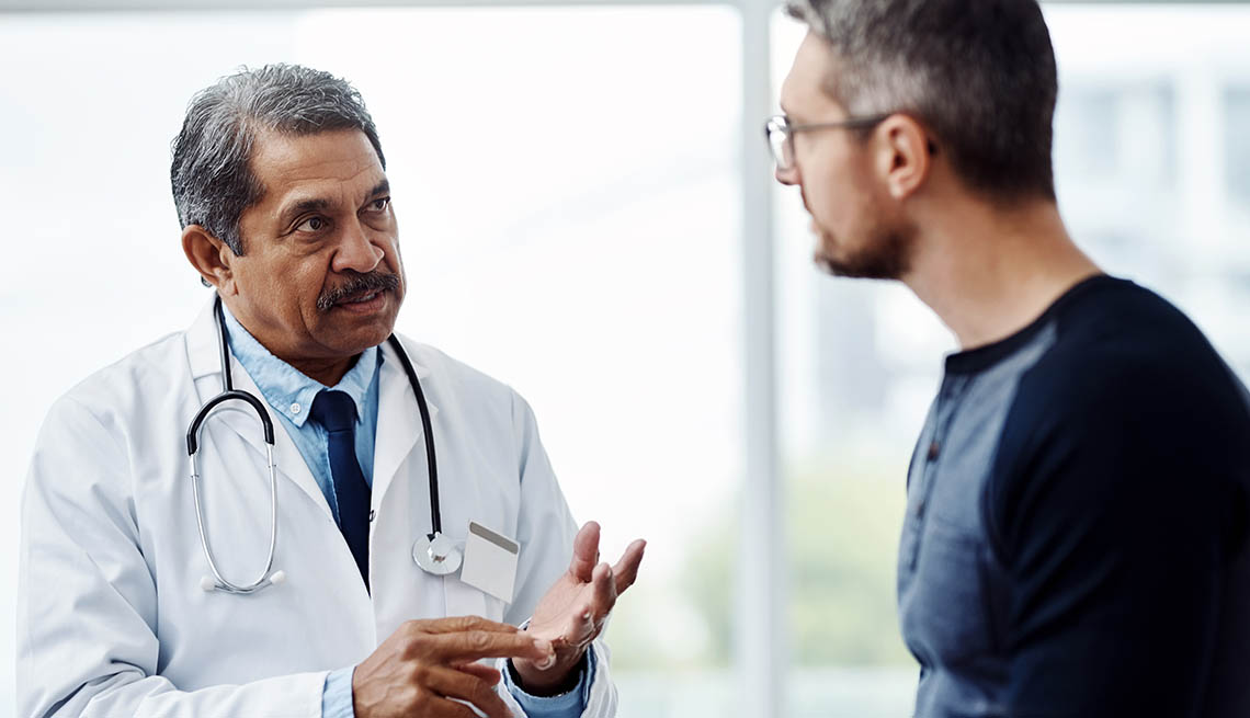 Male doctor and male patient talking