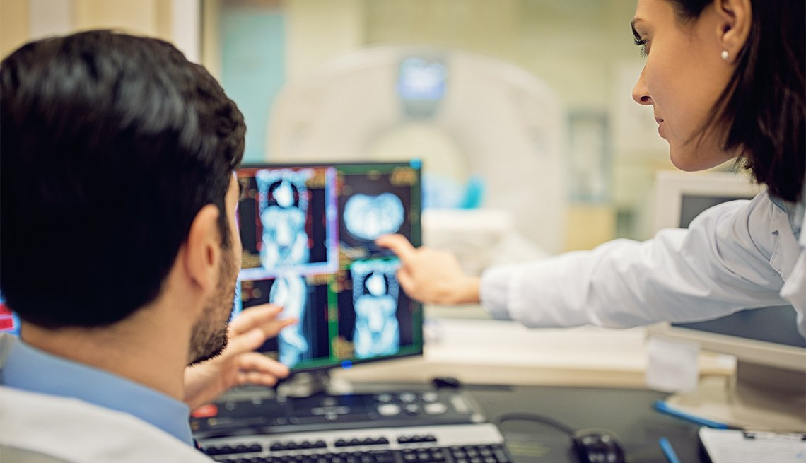 Doctors are working with CT scan in hospital