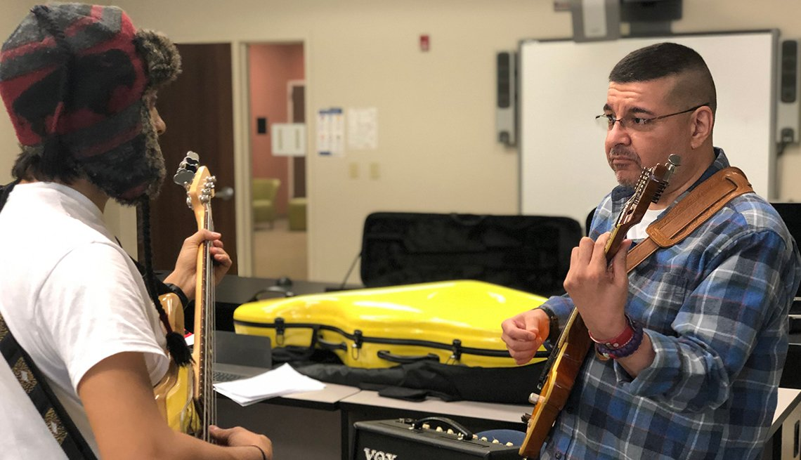 Stroke survivor Gabe Vigil practices a guitar solo for an upcoming performance with his stroke survivor choir in Northern Virginia.