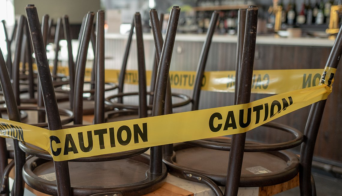 Chairs are wrapped in yellow caution tape