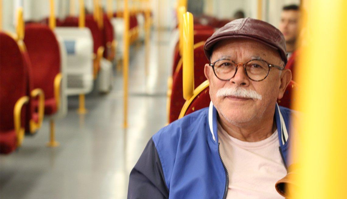 Senior man using public transportation.