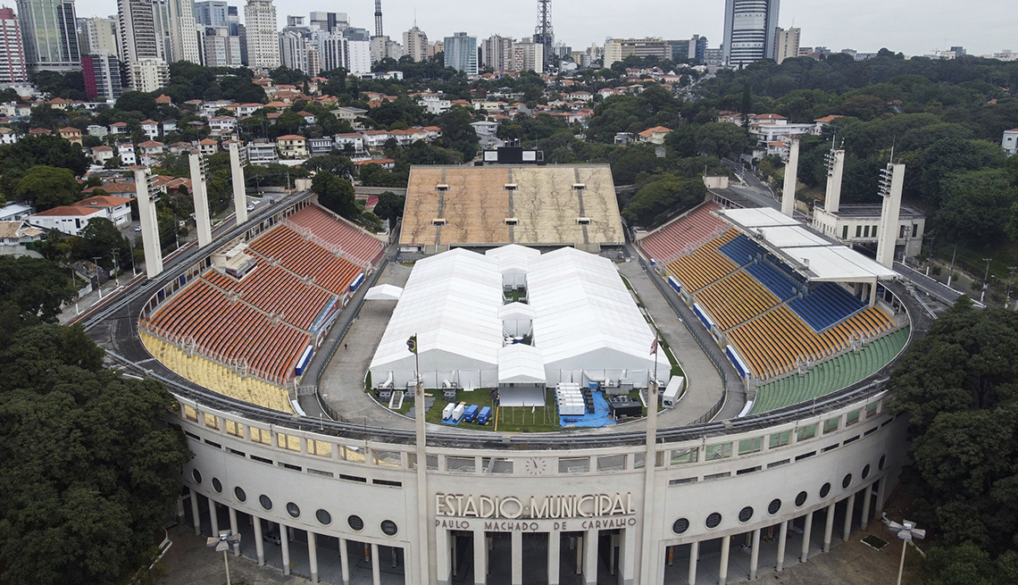item 3 of Gallery image - view from the air of pacaembu stadium with the sao paulo skyline in the background