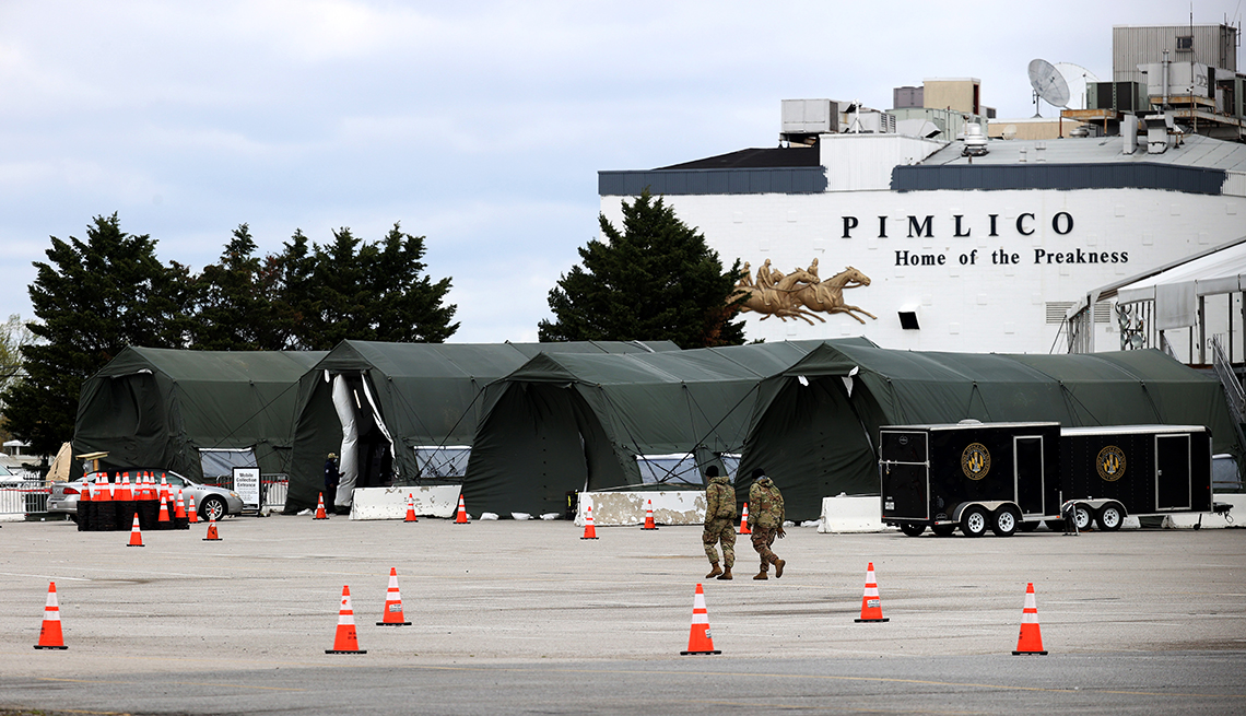 item 1 of Gallery image - large green tents for covid testing are set up in the large parking lot outside pimlico race track
