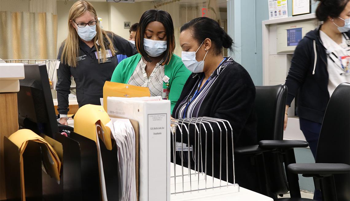 Dr. Teresa Amato, chair of emergency medicine, Cheryl Thomas and Sasha Marsh, emergency department clerks and Kalsang Dickey, emergency department nurse, in the Emergency Department of Long Island Jewish Forest Hills Hospital, one of Northwell Health's 23