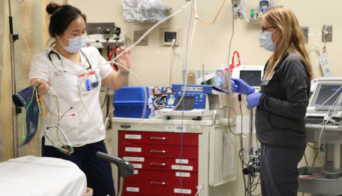 ER Physician Dr. Teresa Amato (at right)  and Kalsang Dickey, RN,.tests tubing in the Emergency Department of Long Island Jewish Forest Hills Hospital, part of Northwell Health.
