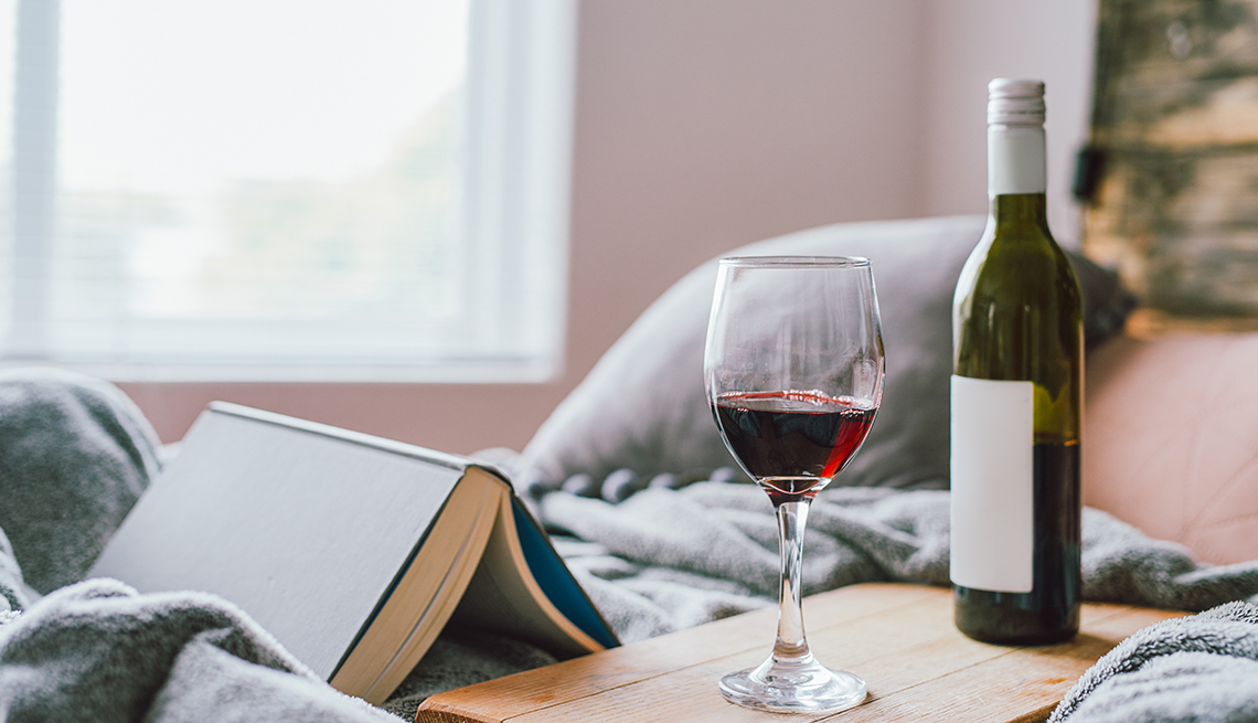 Reading a book and drinking wine