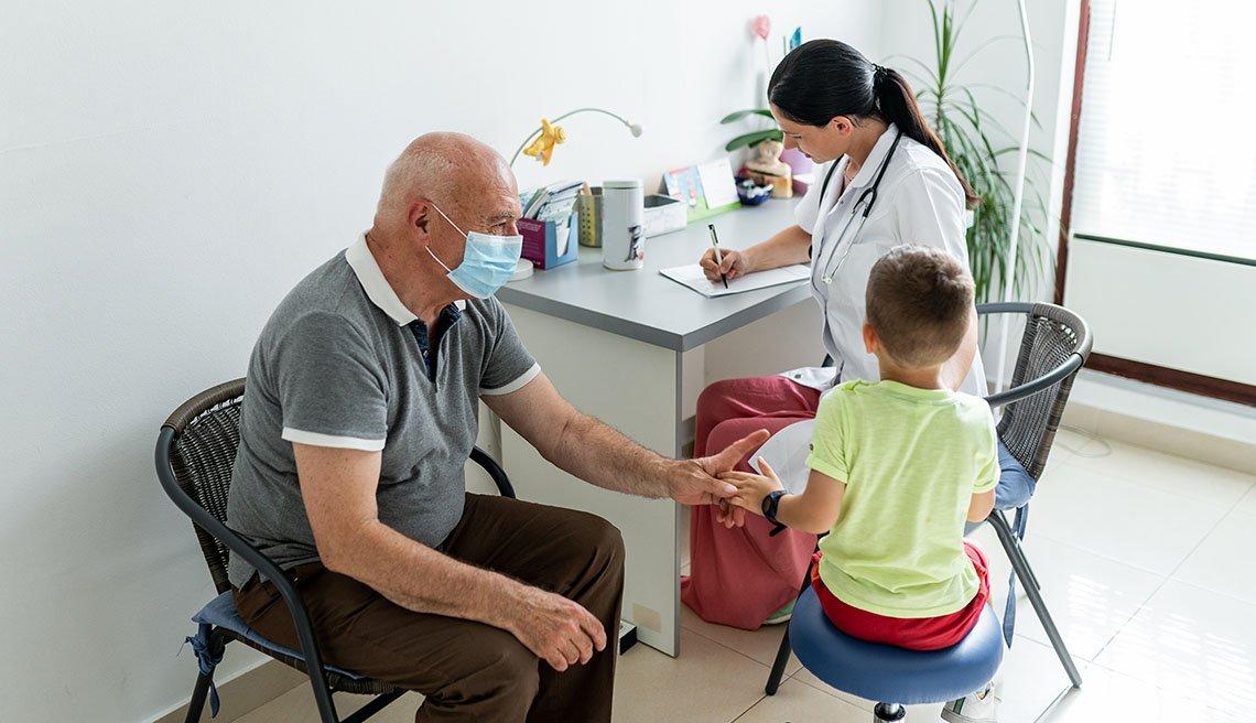 Grandfather accompanies a small boy at a pediatric exam
