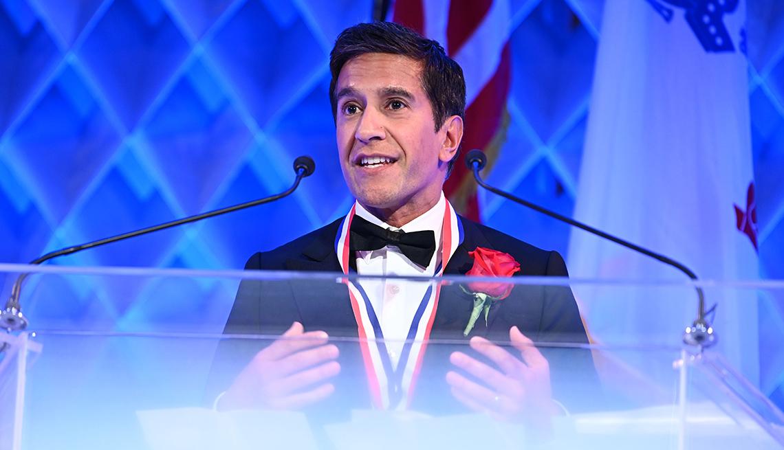 doctor sanjay gupta speaks at a podium