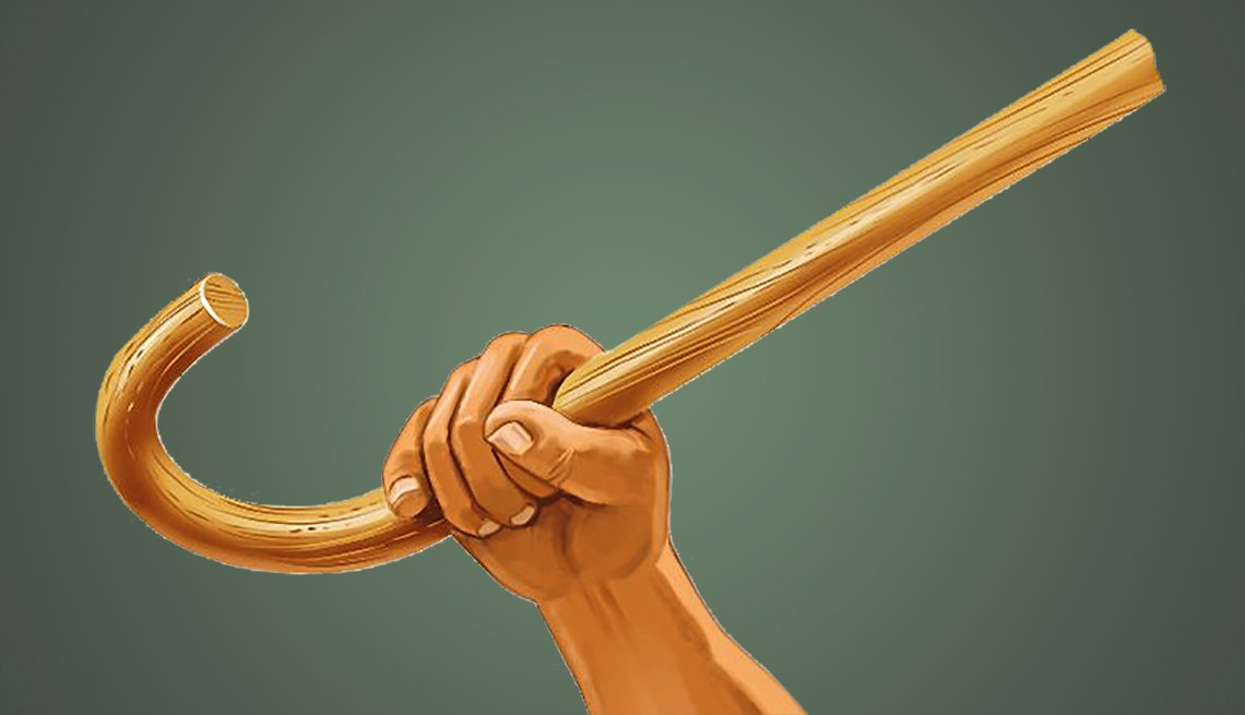 hand and forearm holding a cane up in the air