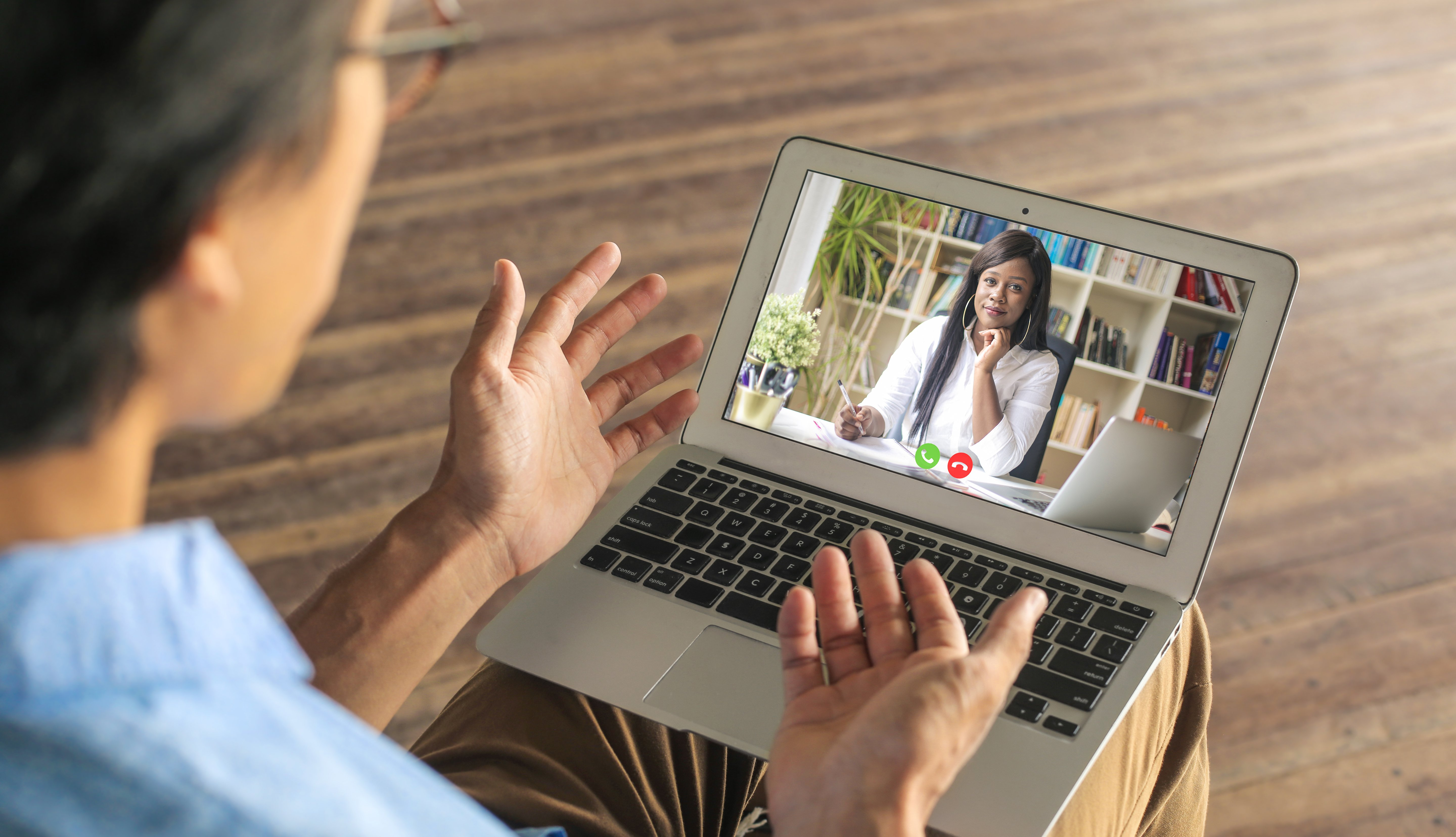 man talking to doctor through a laptop video call