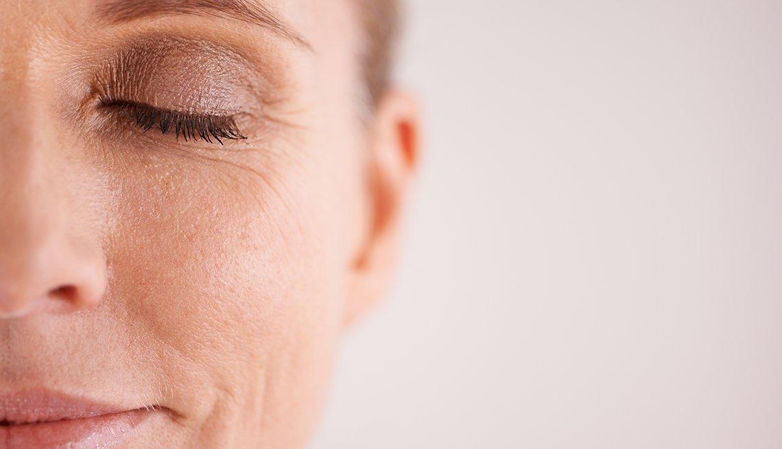 Closeup of a woman wearing eye makeup.