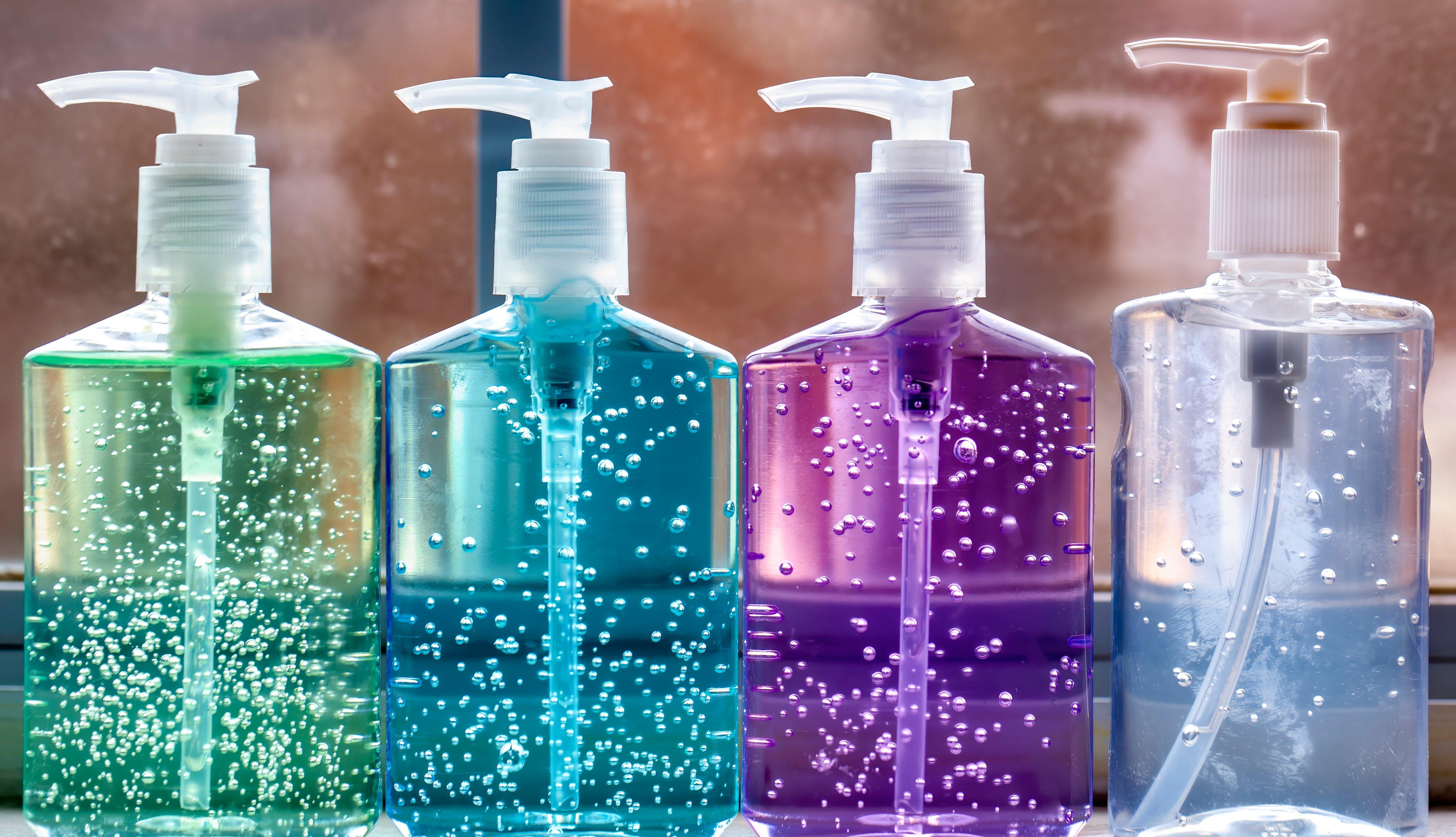 Closeup of four colorful hand sanitizer pump bottles