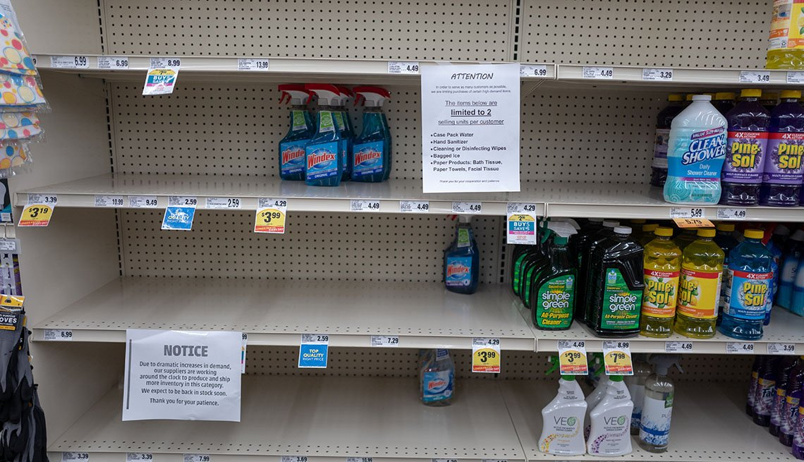 Grocery store shelves empty of most cleaning supplies.