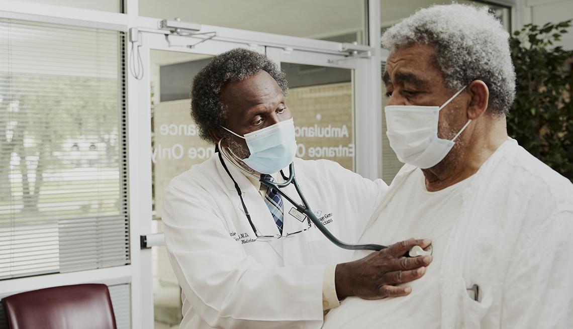 doctor batie examining a patient