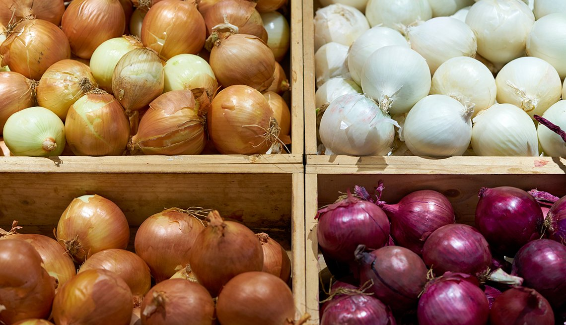 Onions in boxes at a grocery store